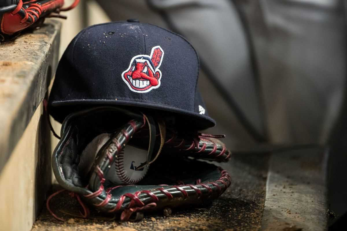 Cleveland Indians baseball cap and glove