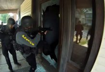 cops breaking down door during a raid