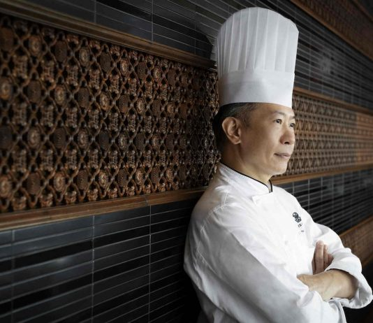 Why do chefs wear tall white hats?